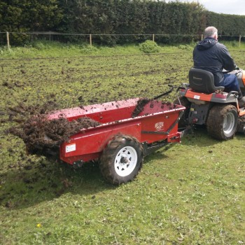 Spreading well rotted horse manure with a Husqvarna ride-on mower
