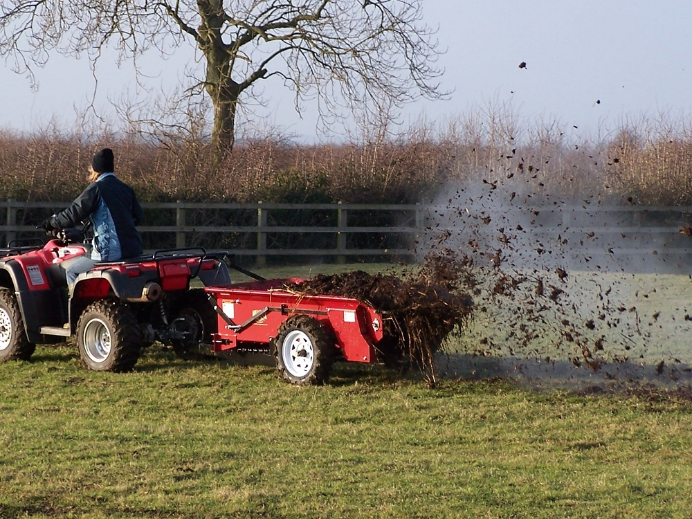 Spreading well rotted horse muck...