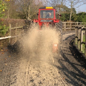 Model 77P spreading sand/rubber mix on riding surfaces