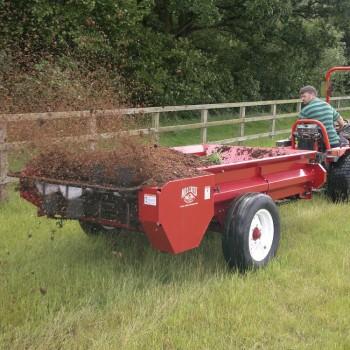 Model 97P spreading with Goldini tractor