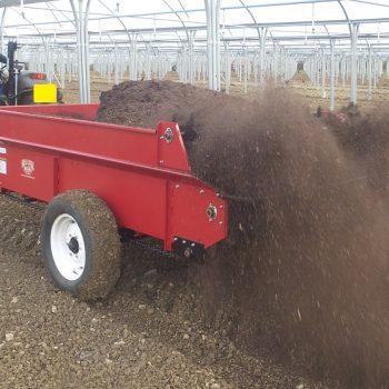 Model 97XLP spreading compost inside nursery poly tunnels.